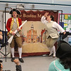 Freedom Trail Scholars Program visits McAuliffe Elementary School for a program reenacting events that led up to the Revolutionary War. Zack Reardon portrays British Captain Thomas Preston and mostly other loyalists, and Arielle Kaplan plays various rebellious colonists. (SUN/Julia Malakie)