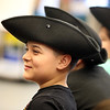 Third grader Duvan Duque watches as Freedom Trail Scholars Program visits McAuliffe Elementary School for a program reenacting events that led up to the Revolutionary War.  (SUN/Julia Malakie)