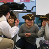 Freedom Trail Scholars Program visits McAuliffe Elementary School for a program reenacting events that led up to the Revolutionary War. From left, Arielle Kaplan organizes third graders playing colonists, from left, Tomas Morales, Sophia Santiago, and Aleyna Rosario. (SUN/Julia Malakie)
