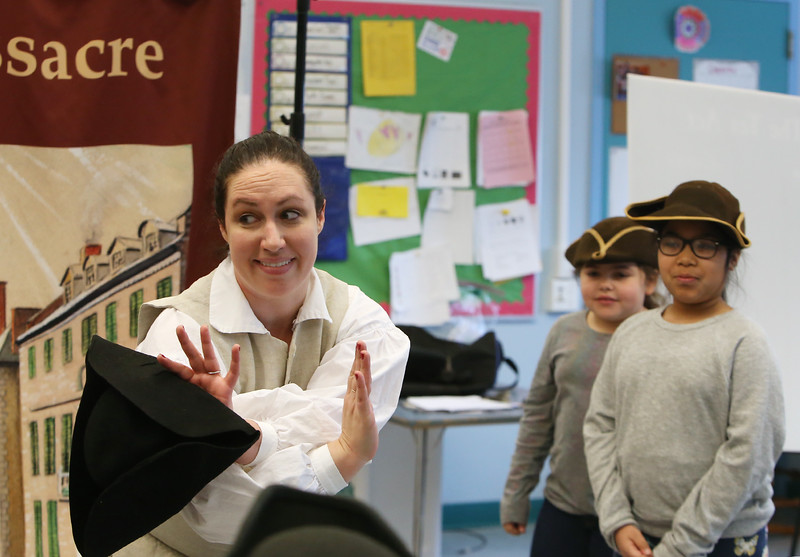Freedom Trail Scholars Program visits McAuliffe Elementary School for a program reenacting events that led up to the Revolutionary War.  From left, Arielle Kaplan, and third graders Sophia Santiago and Aleyna Rosario, as colonists. (SUN/Julia Malakie)