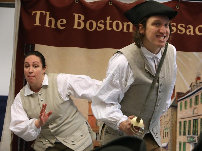 Freedom Trail Scholars Program visits McAuliffe Elementary School for a program reenacting events that led up to the Revolutionary War. Arielle Kaplan, left, and Zack Reardon. (SUN/Julia Malakie)