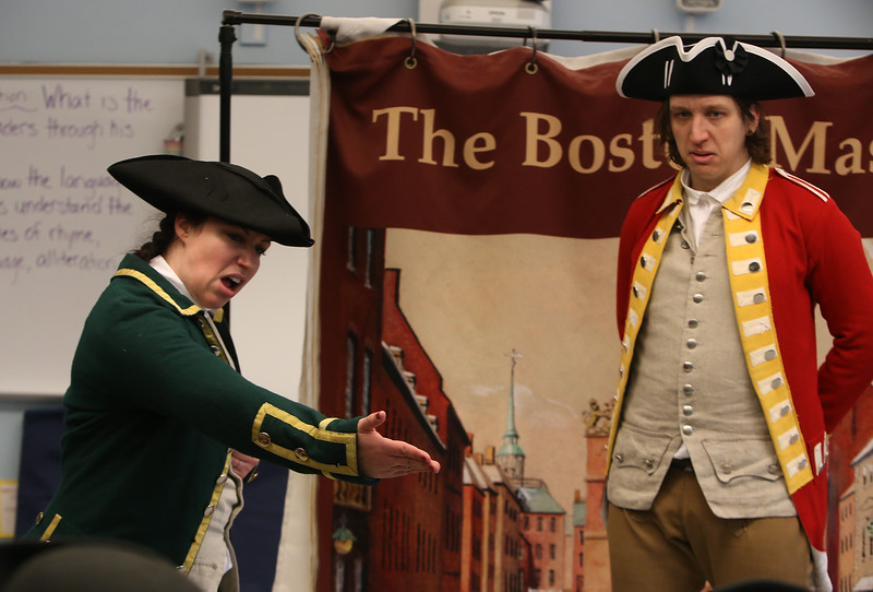 Freedom Trail Scholars Program visits McAuliffe Elementary School for a program reenacting events that led up to the Revolutionary War. Arielle Kaplan as Gov. Thomas Hutchinson, and Zack Reardon as British Army Capt. Thomas Preston, who commanded the troops in the Boston Massacre. (SUN/Julia Malakie)