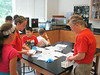 Rebecca Pizzino, an upper school science teacher at Germantown Academy, helps science campers examine forensic evidence to help them solve a mystery June 14. Montgomery Media staff photo / ERIC DEVLIN