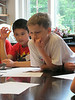 Two Germantown Academy science campers try to solve the mystery of the cookie thief as they work with forensic evidence June 14. Montgomery Media staff photo / ERIC DEVLIN