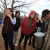 Greater Lowell Tech students tap sugar maples to collect sap to make maple syrup, as part of their environmental science class. From left, senior Kyana Pietrafetta, 18, of Dracut, teacher Tara Alcorn of Dunstable, tasting a drop of sap, Heather Briere of Lowell, senior Hannah Hamelin of Dracut, senior Jacob Benoit, 17, of Lowell (partly hidden, and senior Alex Rodriguez, 17, of  Lowell, watching sap drip from a just installed tap. (SUN/Julia Malakie)