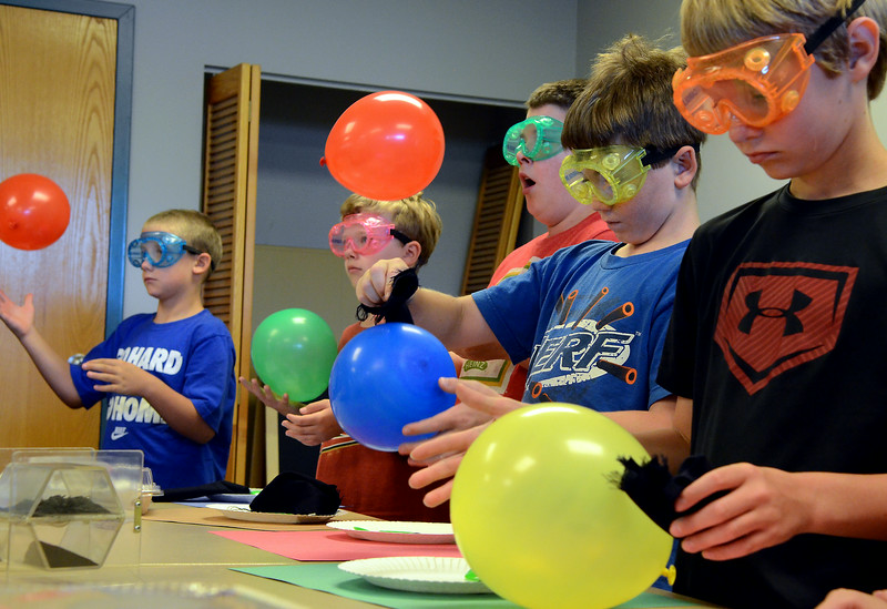 Children conduct experiments in static electricity during the GSK Science in Summer event at the Perkasie Branch of the Free Library of Bucks County on Tuesday July 22,2014.Photo by Mark C Psoras/The Reporter