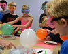 Children take part in experiments in Physical Science & Eelectricity during the GSK Science in Summer event at the Perkasie Branch of the Free Library of Bucks County on Tuesday July 22,2014.Photo by Mark C Psoras/The Reporter