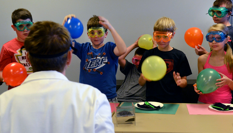 Teacher Rosemary Carr leads children in experiments with static electricity during the GSK Science in Summer event at the Perkasie Branch of the Free Library of Bucks County on Tuesday July 22,2014.Photo by Mark C Psoras/The Reporter