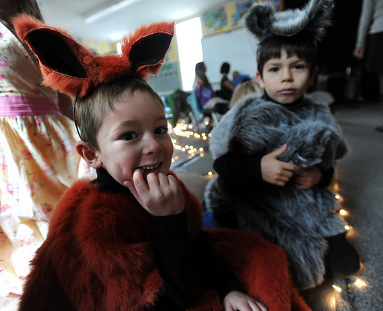 "Juval Stover, left, playing a fox, and  Kaimana Deshincoe, a racoon, wait for their turn to be on stage during dress rehearsal of the Gold Hill school play. Gold Hill Elementary is  performing 3 plays, Little Red Riding Hood, Three Billy Goats Gruff and the Three Pigs,  Wednesday night from the perspective of the villains. For more photos and a video of the rehearsal, go to  <a href=""http://www.dailycamera.com"">http://www.dailycamera.com</a>.<br /> Cliff Grassmick / December 16, 2009"