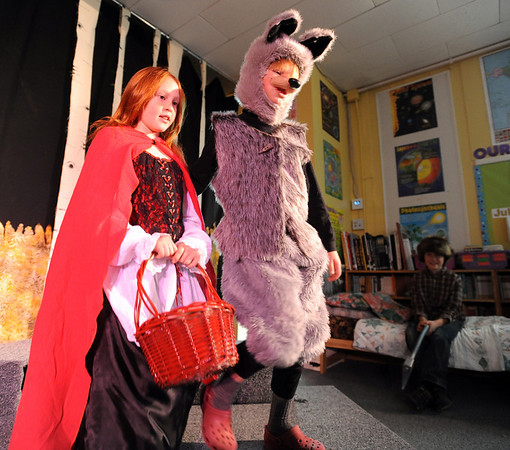 "Siena Tone, playing Red Riding Hood, and wolf escort Sage Wolf,  perform during dress rehearsal of the Gold Hill School play. The  plays are Little Red Riding Hood, Three Billy Goats Gruff and the Three Pigs, told from the perspective of the villains. The performance is Wednesday night at the school.<br />  For more photos and a video of the rehearsal, go to  <a href=""http://www.dailycamera.com"">http://www.dailycamera.com</a>.<br /> Cliff Grassmick / December 16, 2009"