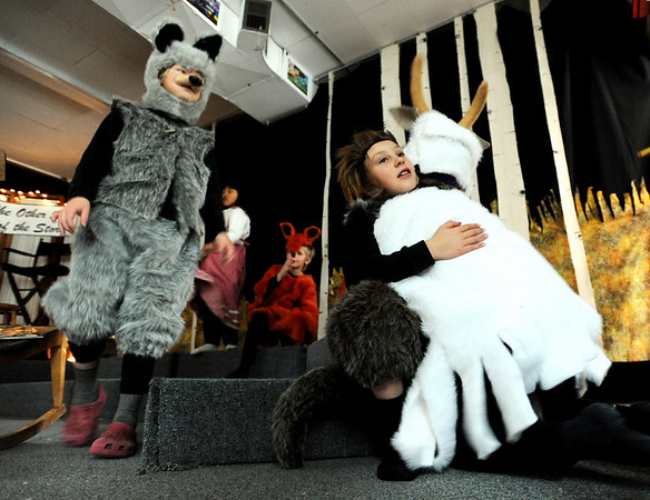 """Big bad wolf Brodi Hawk, hugs one of the billy goats during a break in the dress rehearsal as  wolf Sage Wolf looks on. Gold Hill Elementary  is performing 3 plays, Little Red Riding Hood,Three Billy Goats Gruff and the Three Pigs,  Wednesday night from the perspective of the villains. For more photos and a video of the rehearsal, go to  <a href=""""http://www.dailycamera.com"""">http://www.dailycamera.com</a>.<br /> Cliff Grassmick / December 16, 2009"""
