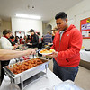 Senior Felix Alejandro, 17, of Fitchburg receives food during Goodrich Academy's annual holiday dinner at the Fitchburg school, Thursday.<br /> SENTINEL & ENTERPRISE / BRETT CRAWFORD