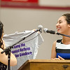 Christina Giadone-Smith presents National Anthem singer Laney Jackson with a T-shirt during the Goodrich Academy graduation ceremony held at Fitchburg High School on Thursday evening. SENTINEL & ENTERPRISE / Ashley Green