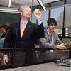 Gov. Charlie Baker tosses a ball back to a robot during a visit to Shawsheen Tech. At right is Shawsheen Tech junior Collin  Powers, 16, of Tewksbury. (SUN/Julia Malakie)
