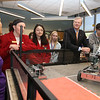 Gov. Charlie Baker visits Shawsheen Tech. From left, electronics instructor Tina Collins, junior Grace Clark of Bedford, junior Christina Paras of Burlington, Samantha Fusco of Wilmington, Baker, and junior Collin Powers of Tewksbury. (SUN/Julia Malakie)