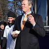 Gov. Charlie Baker eats a Grilled Peanut Butter & Jelly sandwich on his arrival at Shawsheen Tech, which students put on the menu because they'd looked up that it was his favorite. At center is sophomore Rian Callahan, 15, of Billerica. (SUN/Julia Malakie)