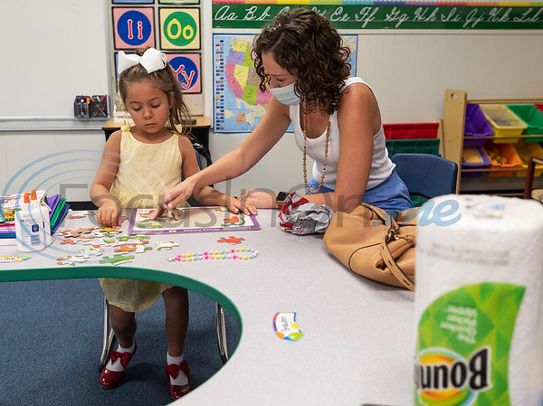 Grace University student Adelyn Tubre, 5, and her mother Amanda Tubre put together a puzzle as they visit the kindergarten classroom during the school's Meet the Teacher event on Tuesday, Aug. 25, 2020. Grace University is a hybrid school through Grace Community School where students receive instruction on campus two days a week and spend three days a week learning from home in a homeschool environment.
