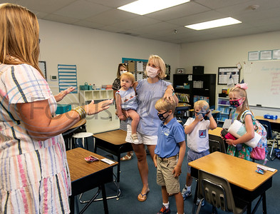 Grace University teacher Sundee Nutt, far left, talks with Callie Bohl of Tyler as she visits Nutt's classroom with her children for Meet the Teacher on Tuesday, Aug. 25, 2020. Grace University is a hybrid school through Grace Community School where students receive instruction on campus two days a week and spend three days a week learning from home in a homeschool environment.