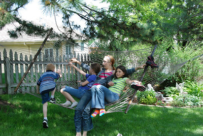 Graduation party one: At the home of Sarah Schafer and her triplet sisters, Morgan and Christine, and foster sister Valencia Dotson. Looks like the hammock's getting full!