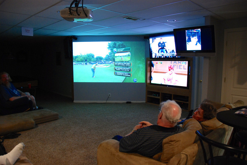 Graduation party 3: Now THIS is a MAN CAVE. Five TVs in this basement, plus a full kitchen. Manly men men men. . . .