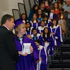 Jeremy gets his diploma from the superintendent.
