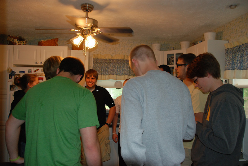 Jeremy's friends gathered in the kitchen.