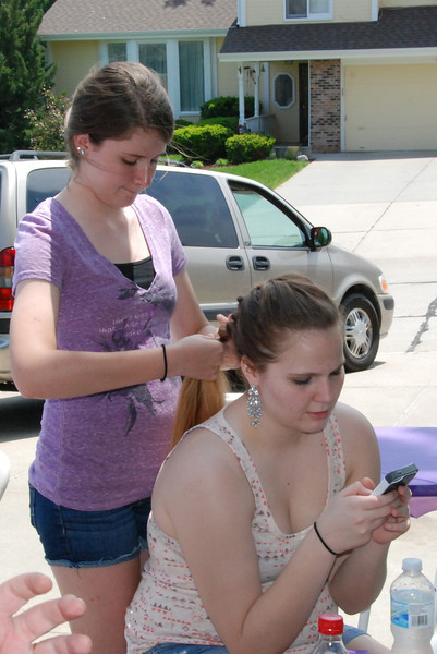 Morgan gets her hair braided.
