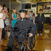 Daleville High School graduate Taylor Davis wheels himself in during the processional.