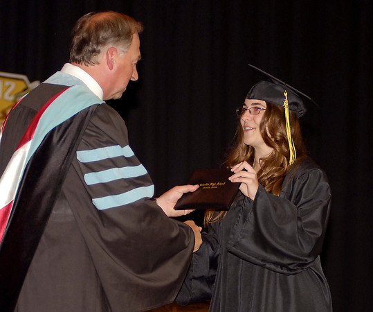 Shelby Looper receives her diploma from Superintendent Paul Garrison during Daleville High School Commencement exercises Friday evening.