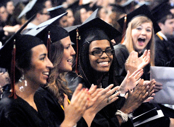 John P. Cleary | The Herald Bulletin<br /> These Anderson University students cheer and applaud as they were pronounced graduates during  Commencement exercises Saturday.