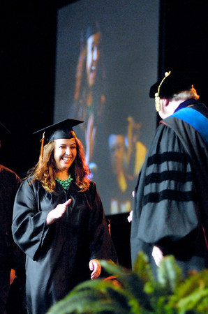 John P. Cleary | The Herald Bulletin<br /> Margaret  Torbeck was all smiles as her name was read while crossing the stage to be greeted by university president James Edwards during the 96th Commencement of Anderson University.