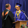 Chris Martin for THB<br /> Elwood Principal David Retherford presents Valedictorian Dakin Updegraff with his diploma Sunday during Elwood's 2014 graduation