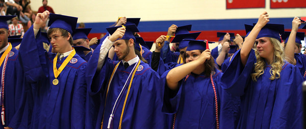 Chris Martin for THB<br /> The changing of the tassel during Elwood's 2014 graduation on Sunday