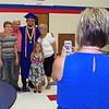 Jordan Arehart poses for photos following his graduation from Elwood High School on Sunday.