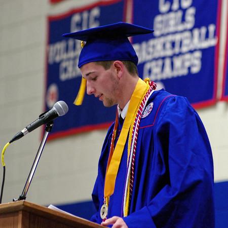 "Austyn Poor, Salutatorian, speaks to his classmates about ""Looking Back, Moving Forward"" during Elwood High School graduation ceremonies."