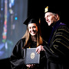 Don Knight | The Herald Bulletin<br /> Alyssa Cummings receives her Bachelor of Arts degree from Anderson University President John Pistole during AU's commencement on Saturday.