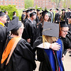 Don Knight | The Herald Bulletin<br /> Professors congratulate their students during the processional as Anderson University held their 98th commencement on Saturday.