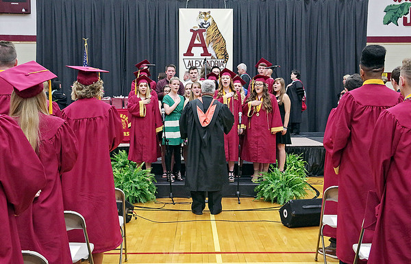The Crescendoz are joined by graduating senior choir members for the singing of the National Anthem during graduation exercises at Alexandria-Monroe High School on Friday evening.
