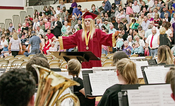 Mark Maynard | for The Herald Bulletin<br /> Graduating Senior Vicki Henkelman directs her fellow Alexandria High School Band members prior to Commencement on Friday evening.