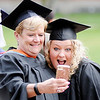 Don Knight   The Herald Bulletin<br /> A professor poses for a selfie with a student during the precession at Anderson University's 99th Commencement on Saturday.
