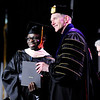 Don Knight | The Herald Bulletin<br /> Zakiyou Sounkere accepts his Master of Business Administration degree from Anderson University President John Pistole during AU's 99th Commencement on Saturday.