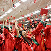 Don Knight | For The Herald Bulletin<br /> Students toss their mortar boards in the air at the end of Anderson High School's graduation on Tuesday.