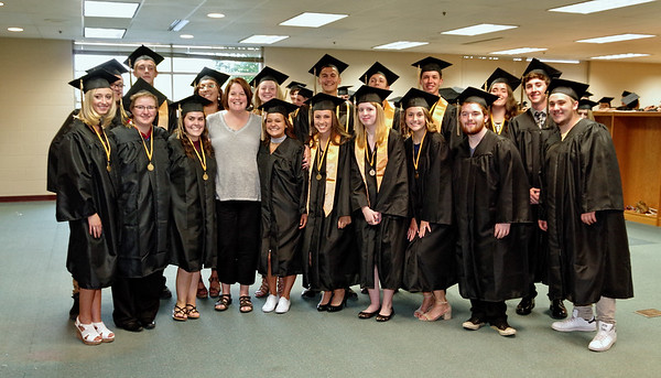 Mark Maynard | For The Herald Bulletin<br /> A group of graduating seniors from the Daleville High School Class of 2017 share a moment with their sixth grade teacher, Mrs. Wordinger prior to commencement exercises.