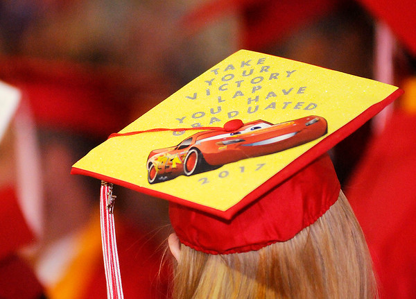 Don Knight | The Herald Bulletin<br /> A student decorated her mortar board as Frankton held their Commencement on Friday.