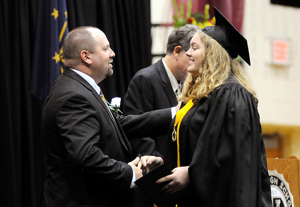 Don Knight | The Herald Bulletin<br /> The Class of 2017 continued the tradition of handing Principal Chad Kemerly something as they walk across the stage during Lapel's graduation on Saturday. This year they gave him forks.