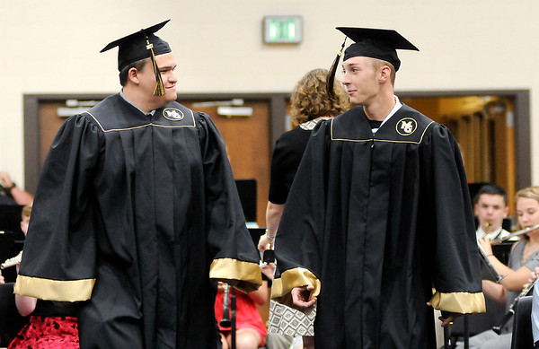 "Don Knight | For The Herald Bulletin<br /> Graduates walk to their seat as the band plays ""Pomp and Circumstance"" as 90 students received their diplomas during Madison-Grant's graduation on Friday."