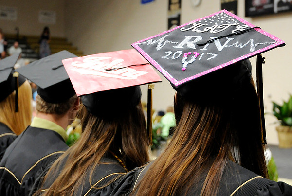Don Knight | For The Herald Bulletin<br /> Katelynn Ailes, right, decorated her mortar board with a nursing theme. She was the only graduate to receive both an Academic Honors and Technical Honors diploma.
