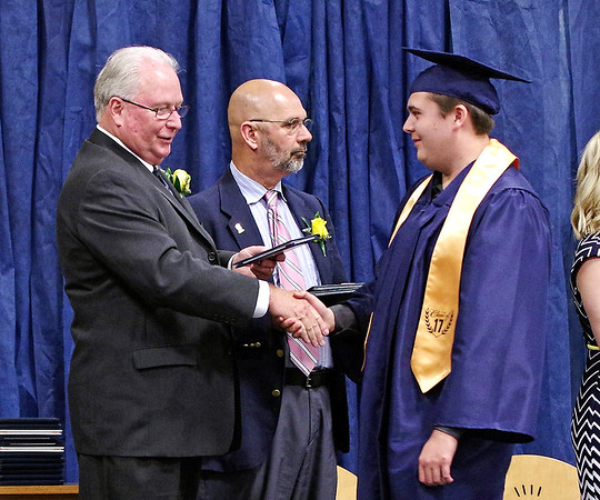Mark Maynard   for The Herald Bulletin<br /> Graduating Senior Aaron Atkins receives his diploma and congratulations from Shenandoah High School Superintendent Ronald Green.
