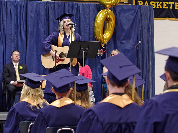 "Mark Maynard | for The Herald Bulletin<br /> Graduating Senior Quinn Hartley sings ""Class of '17"", which she composed, during commencement at Shenandoah High School."