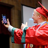 Don Knight | The Herald Bulletin<br /> Tanner Harvey takes a selfie as he walks to receive his diploma during Anderson's graduation on Tuesday.